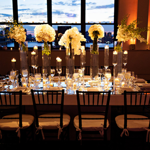 photo: elegant nighttime wedding setup tribecarooftop