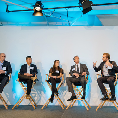 photo: 5 person panel on stage at a corporate event at tr360