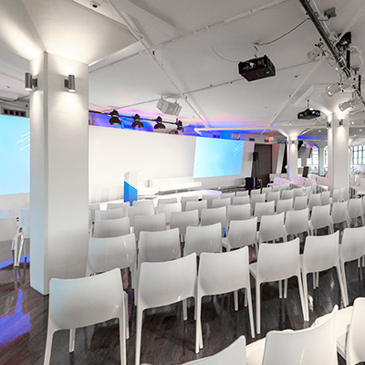 photo: theater style setup with all white furniture before a event