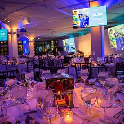 photo: seated dinner set up with multimedia presentation at tr360