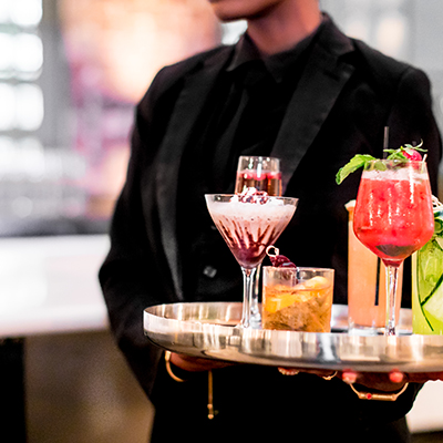 photo: waiter carrying tray of colorful beverages