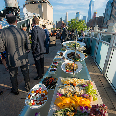photo: mediterranian appetizer table on rooftop at corporate event
