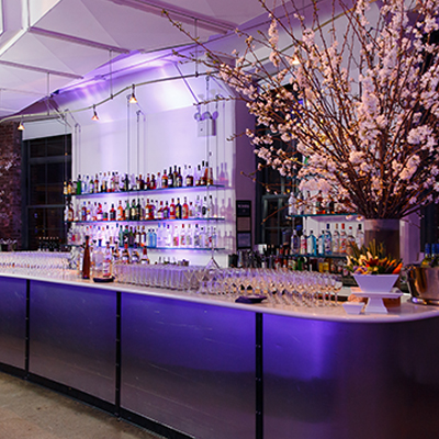 photo: main bar with glassware and floral arrangements
