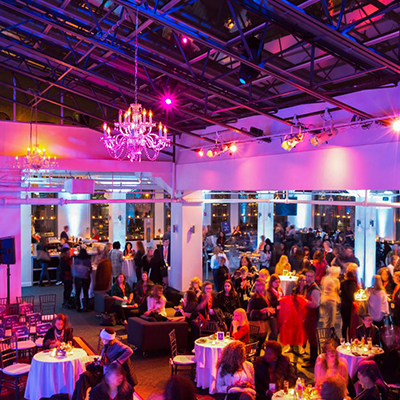 photo: seated corporate dinner with pink uplighting
