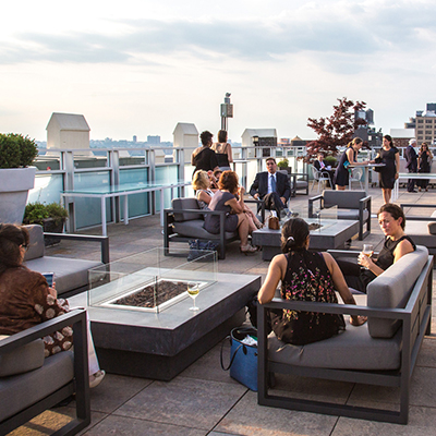 photo: rooftop corporate event people sitting on lounge furniture