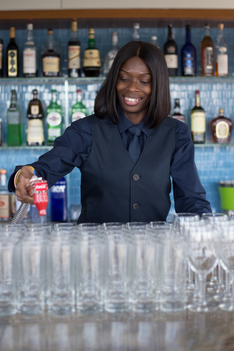 photo: female waiter pouring drinks at event